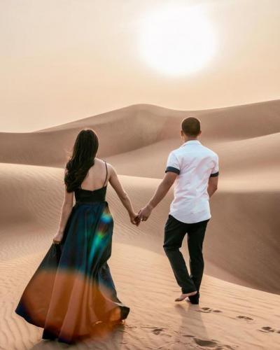 Couple Enjoying in Dubai Desert