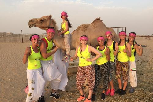 Group Enjoying Camel Ride During Morning Safari