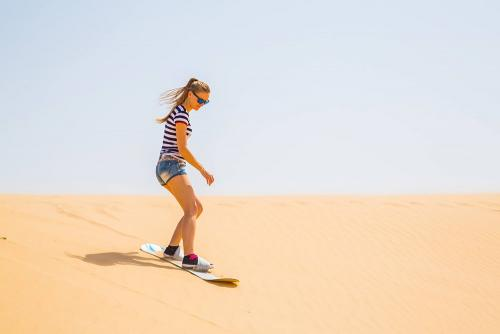 Lady Enjoying Sand Boarding