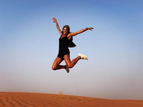 Lady Enjoying During Desert Tour
