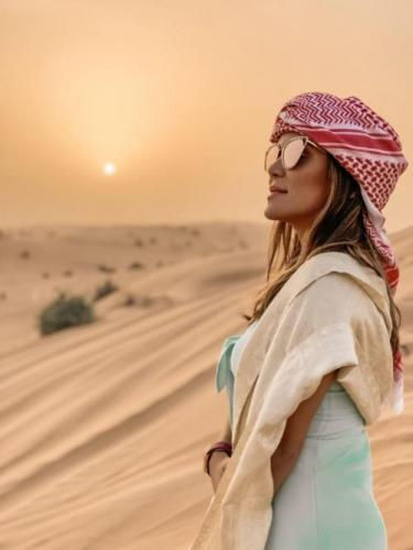 Tourist in Dubai Desert With TDS
